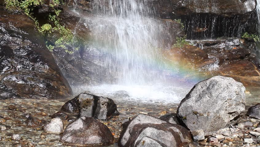 Waterfall and rainbow close up in the forest, Nepal