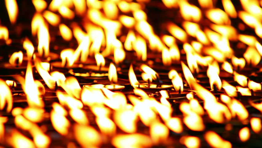 Candles burning at the holy Buddhist site of Boudhanath, Kathmandu, Nepal