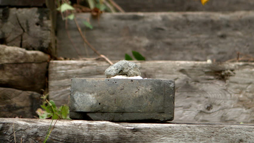 Sledge hammer smashing a concrete block in slow motion