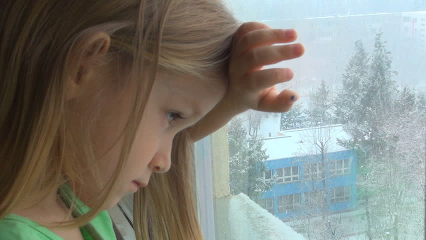 Sad, Unhappy Caucasian Child Looking Out Window, It's Snowing, Depressed Blonde Little Girl, Children - HD stock footage clip