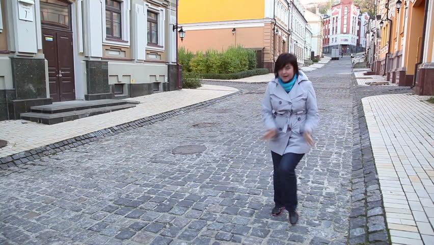 woman dancing in the street 2