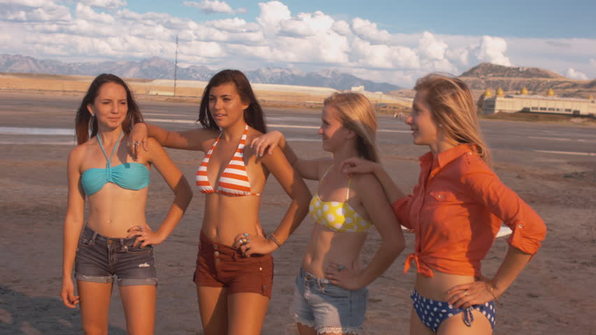 Four Attractive, Playful Teenage Girls Dancing, Having Fun On The Beach (With Sunny 