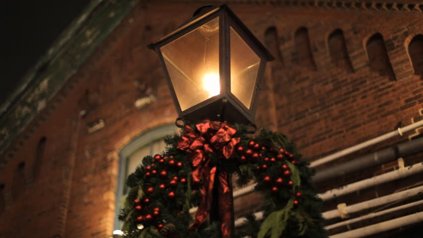 Old Fashion Gas Street Lamp From The Victorian Era Decorated With A Wreath For Christmas Burning Bright At Night In A Historic Part Of Toronto Canada