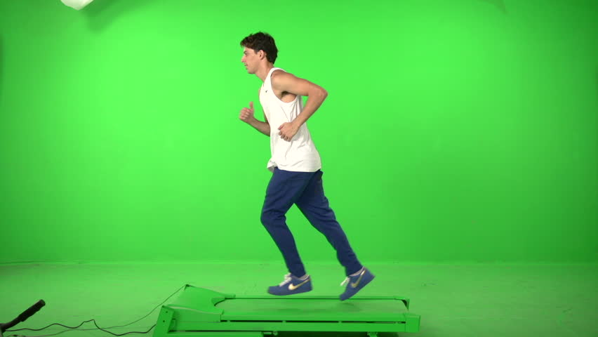 Man runing on a green screen backround