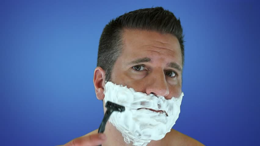 Man Shaving in High Speed Followed By Wearing a Suit and Tie