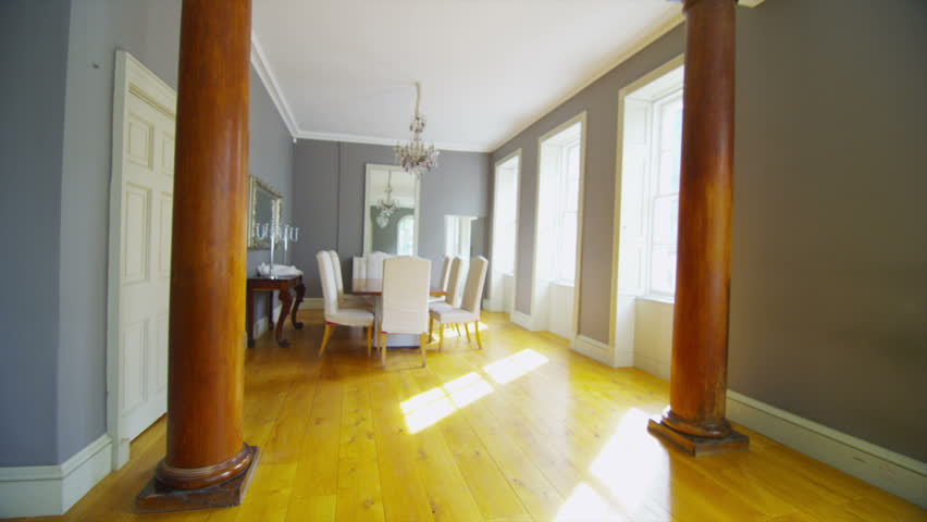 View of elegant dining room and living area in a stylish for Dining room no windows