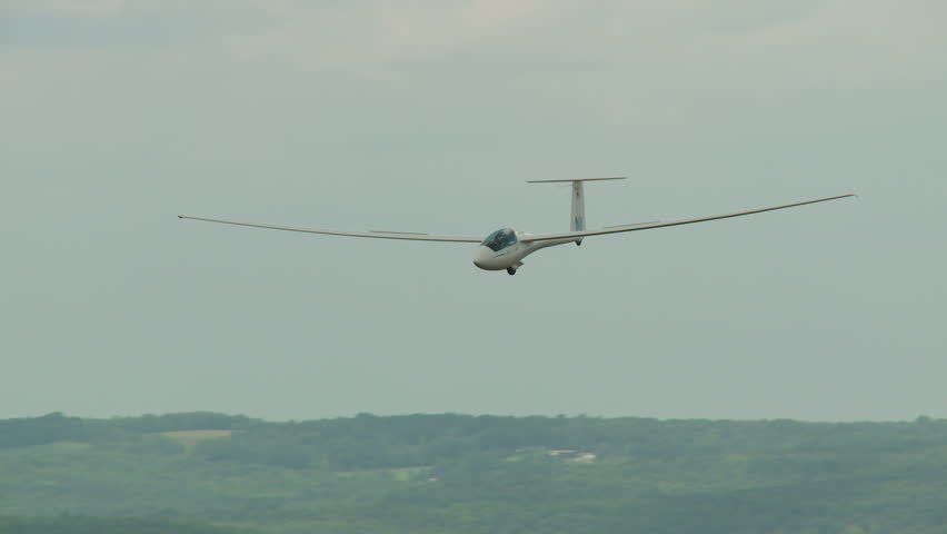 ELMIRA, NY - AUGUST 2: Pilot Andrew Brayer brings his ASW-20C sailplane in for a landing during the 2013 SSA Region 3 Soaring contest at Harris Hill gliderport on August 2, 2013 in Elmira, New York.