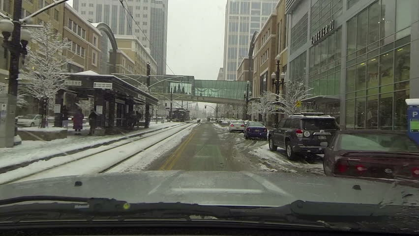 SALT LAKE CITY, UTAH DEC 2013: Economic and business downtown. Snow storm POV HD. Winter snow storm hit West extreme cold weather and snow. Dangerous driving conditions on snow packed and icy roads - HD stock video clip