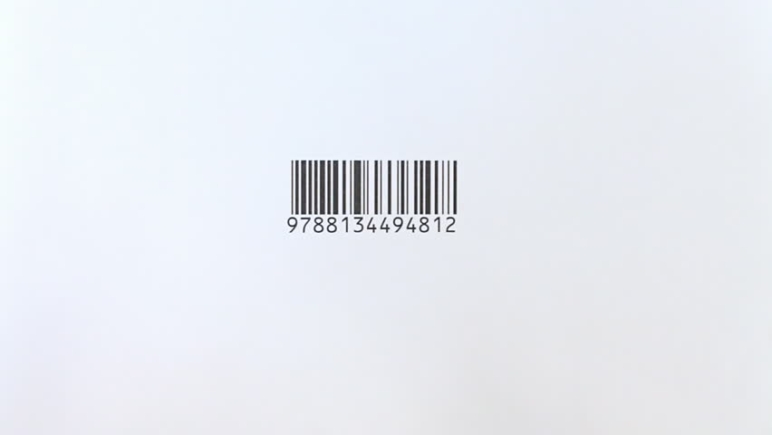 Close up of a small barcode reading with a handheld reader gun. The scanline is red while reading.