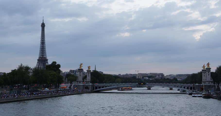 Landmark Famous Eiffel Tower Paris Seine River Alexander III Bridge Traffic Dusk  ( Ultra High Definition, Ultra HD, UHD, 4K, 2160P, 4096x2160 ) - 4K stock video clip