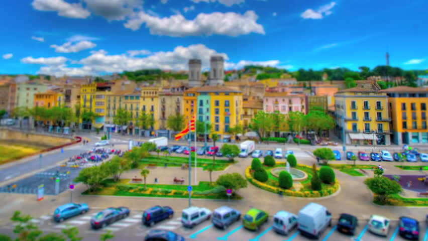 Girona, Spain from above in tilt shift and time lapse style. Girona is the capital of the Costa Brava region in Spain, which is part of the larger Catalonia district. - HD stock footage clip