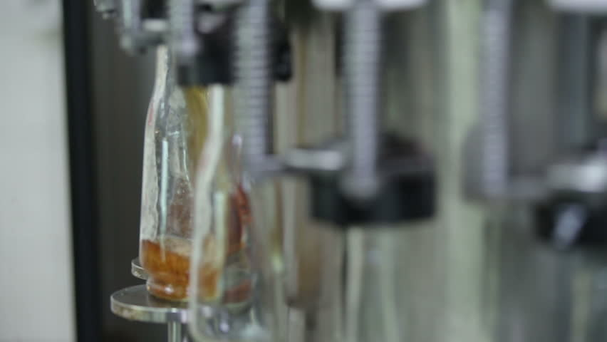 slightly gap-filling bottle of cognac - HD stock video clip