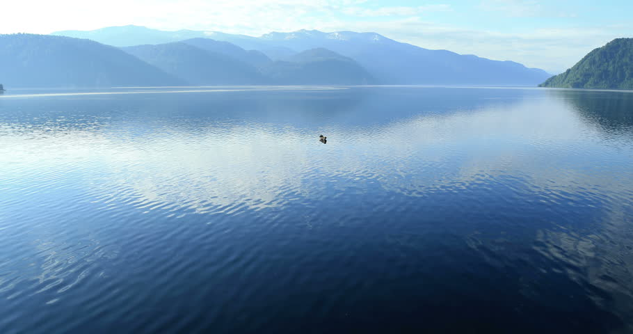 Flight over the mountain lake. Altai. Siberia