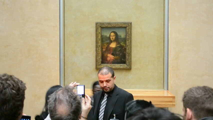 """PARIS - JAN 02: Visitors take photos of Leonardo DaVinci's """"Mona Lisa"""" at the Louvre Museum on January 02, 2014 in Paris, France. The painting is one of the world's most famous works of art.  - HD stock video clip"""