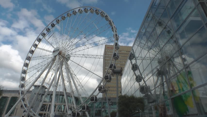 MANCHESTER, U.K. - JUNE 2012: Time Lapse of The Manchester wheel is an attraction in Exchange Square that has been moved to Edinburgh, Scotland