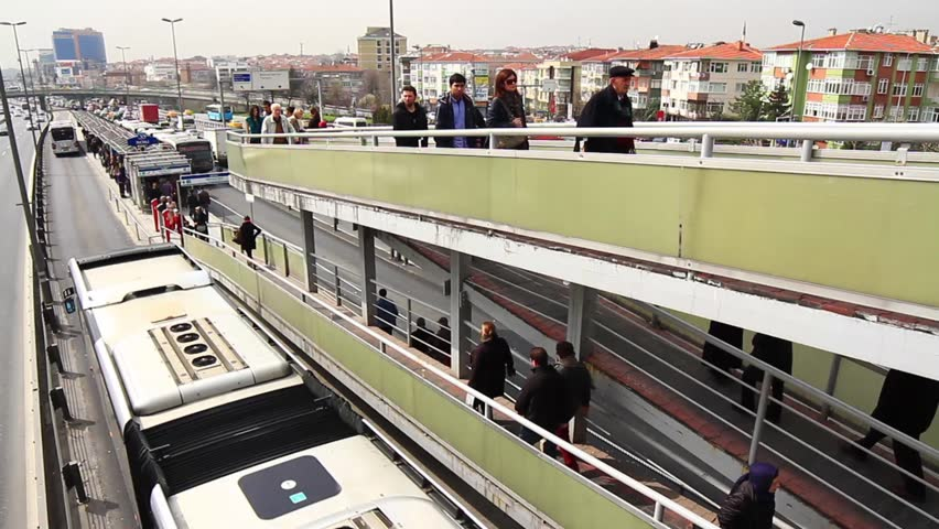 ISTANBUL - MAR 20, 2013: Metrobus passes under overpass in Turkey. Metrobus line planed as a solution to transport problem with a daily capacity of 800,000 passengers/day. Incirli bus stop