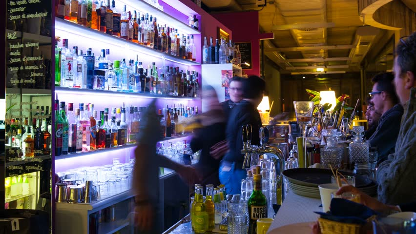 BOLOGNA, ITALY - JANUARY 15, 2014: Time lapse of people in Be Towers bar in Budrio, Bologna, Italy. This is the most famous bar in Budrio and young boys came from all over the city to its parties. - 4K stock video clip