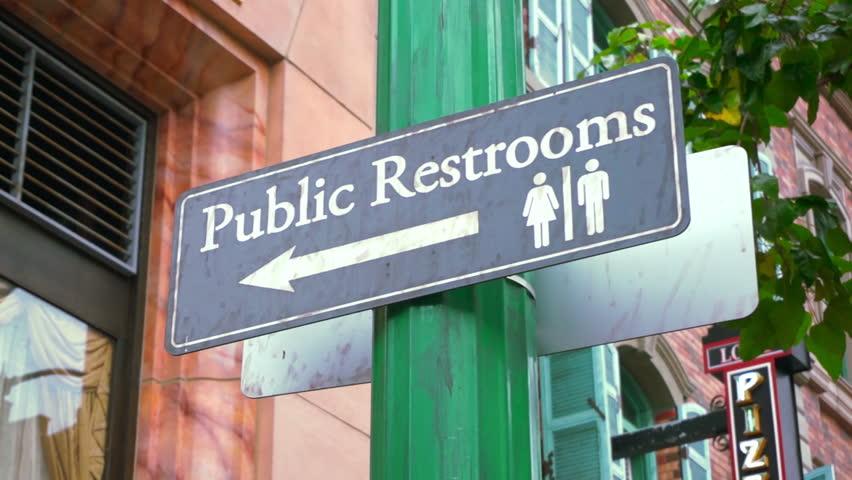 Public Restroom. Direction signage of public restroom.