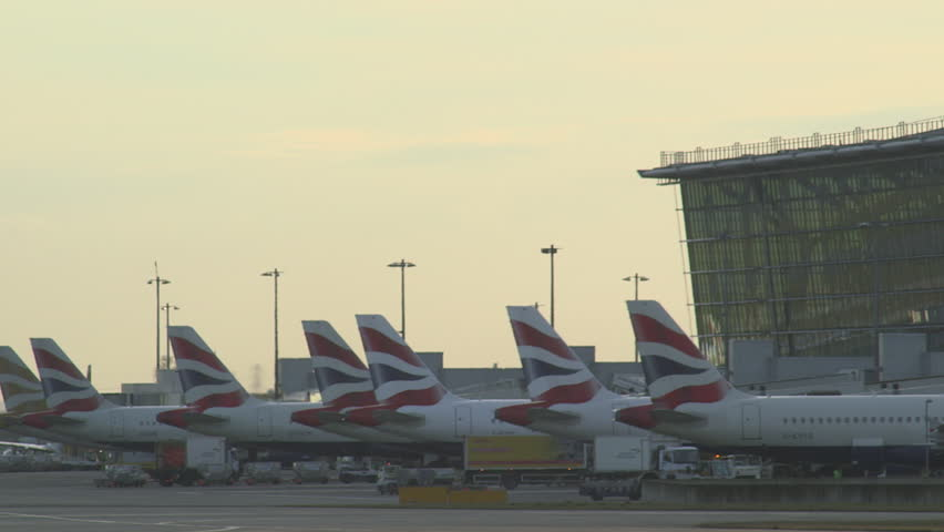 LONDON, JANUARY 21 : British Airways passenger plane being driven to hangar at Heathrow Airport, London, UK, 2014