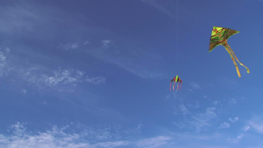 Two Colorful Kites In The Blue Sky. Slow Motion. Colorful ...