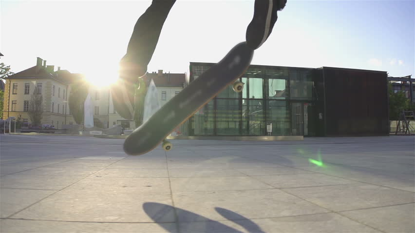 Skateboarder does flip at sunset - HD stock footage clip