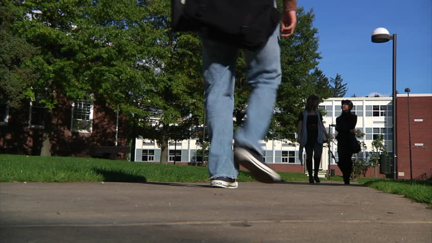 College students walk to class. - HD stock video clip