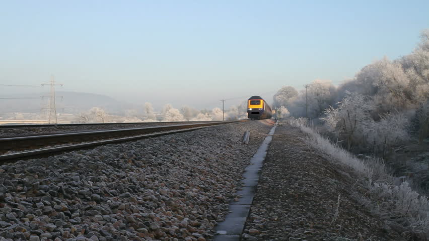 Inter City High Speed Train (HST) in UK going past from right to left approaching station.