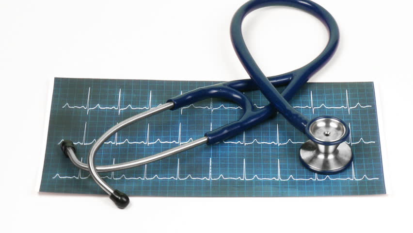 Stethoscope turning on an electrocardiogram - HD stock footage clip