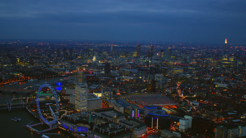 4K Aerial shot of Central London at night with view of London Eye, Waterloo Station, St Paul's Cathedral, River Thames, The Shard, OXO Tower, The Gherkin