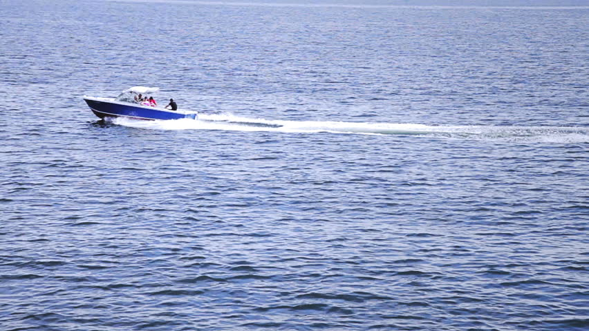 High Angle of View of a fast boat in the middle of the Ocean