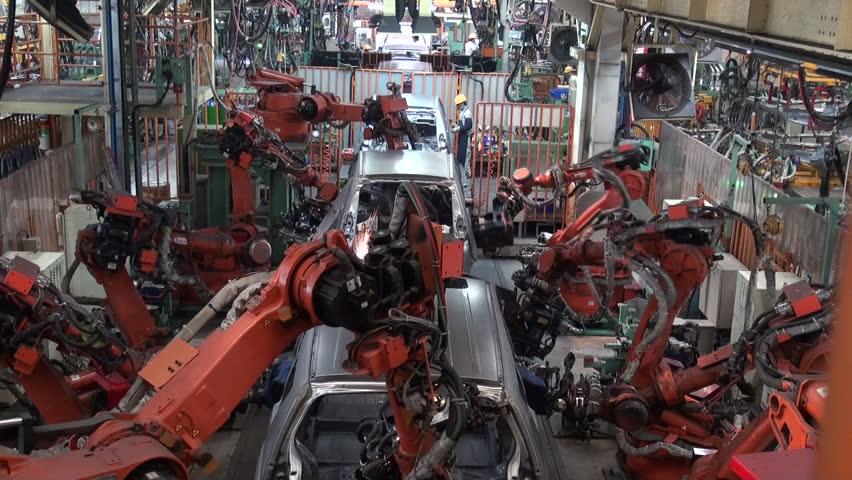 Car factory. Robotic arm making car in line