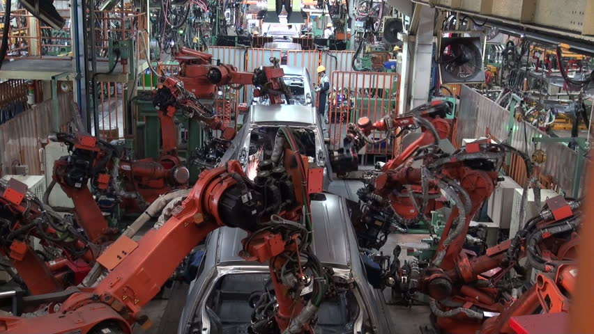 Car factory. Robotic arm making car in line