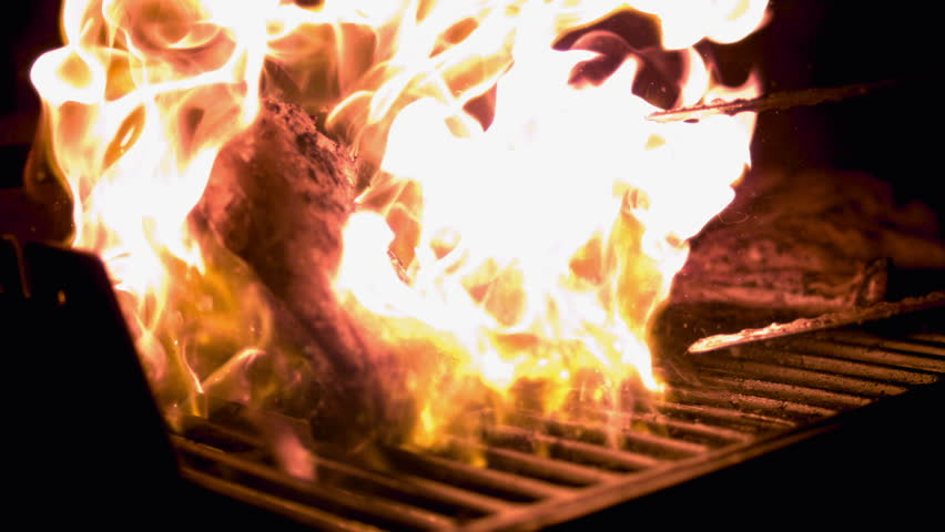 Grilling Barbecue Chicken. Slow Motion 1000fps. Fiery Grill Top Flaming As Chicken Is Being Cooked. (Shot On Phantom)