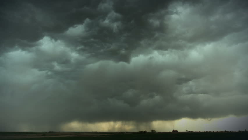 Massive thunderstorm moves over eastern Colorado, with cumulus clouds and virga. HD 1080p timelapse.