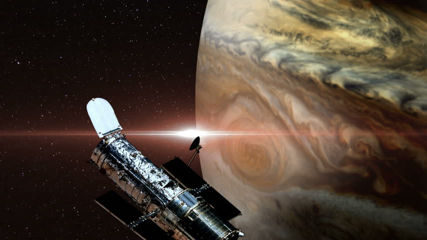 Hubble Space Telescope Passing Over Jupiter