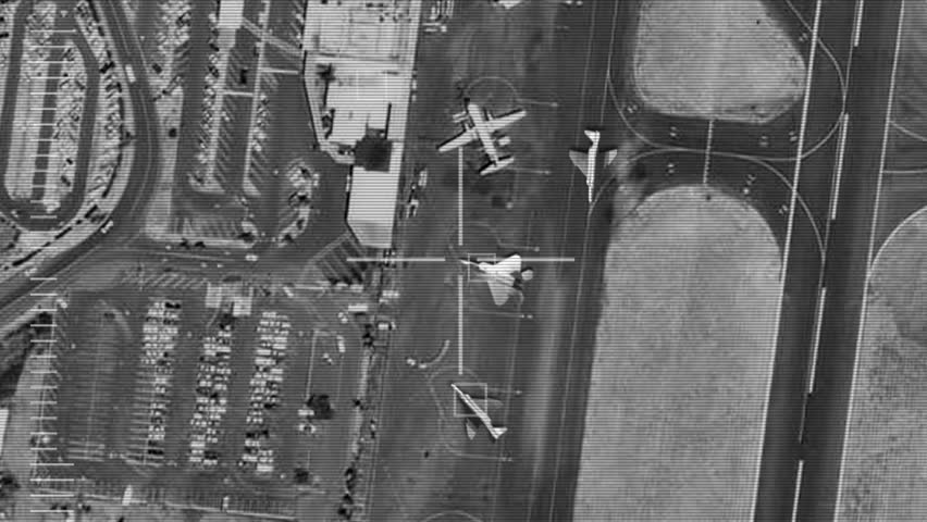 Smart bomb attack on enemy airfield and planes (Gun camera view)