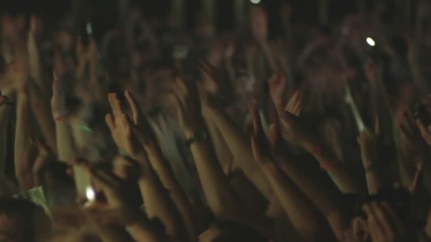 Republic of Belarus, Minsk, February 21, 2014 Minsk-Arena City. the performance of the famous German DJ Armin van Buuren. People dancing waving, changes color, flashes of light.