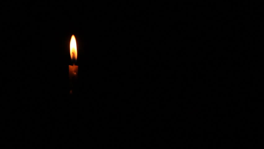 Candle flame blowing off by wind