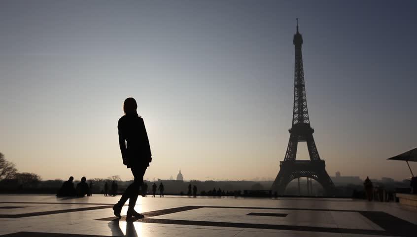 happy couple near Eiffel tower in Paris, France