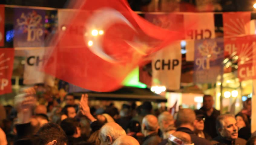ISTANBUL - MARCH 16, 2014: CHP deputy parliamentary group chair Muharrem Ince slams the government over corruption during election rally at Maltepe. Crowd of people waving Turkish flags in CHP meeting