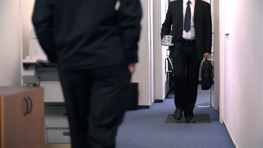 Slow Motion of Businessman Crashing In Hallway