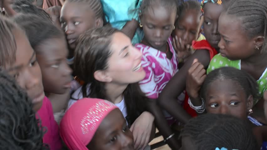 MATAM,SENEGAL-CIRCA NOVEMBER 2013:Actress Caterina Murino greets the children of an elementary school,Caterina Murino is the testimonial of the NGO AMREF,circa November 2013.