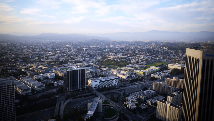 4K Time Lapse of Aerial Cityscape at Sunset in Los Angeles -Tilt Up-