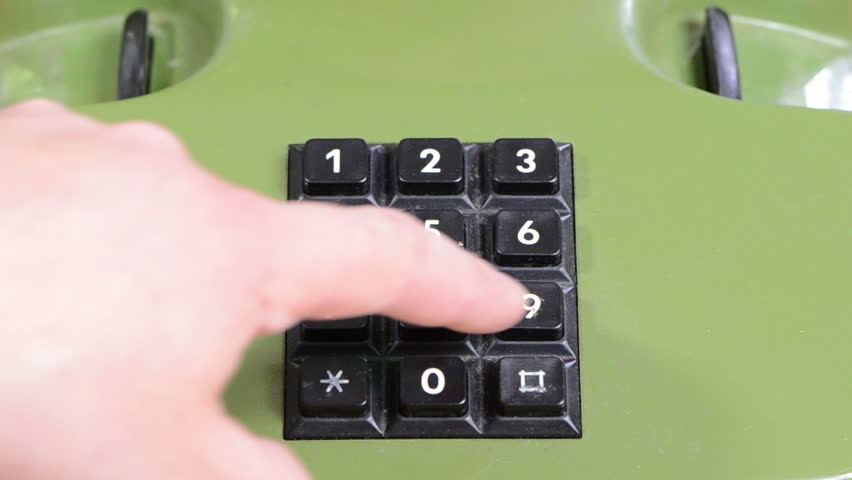 Human fingers press buttons with numbers on old retro telephone. Dialing with home phone. - HD stock footage clip