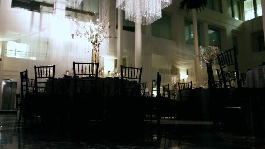 Wide of a dark banquet hall.