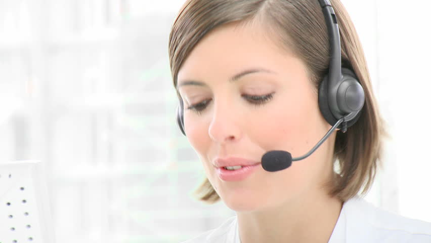 Close-up of smiling woman working in a call center. Customer service. Footage in high definition  - HD stock footage clip