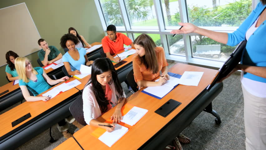 Modern Classroom With Students : Young multi ethnic male female college students working in