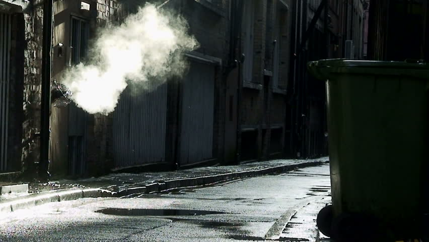Steam coming from outlet in dirty, dark back alley
