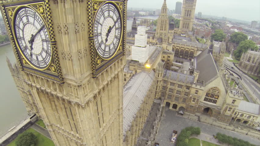 Aerial View, London. Camera flying high above the Houses of Parliament. Big Ben in front view.