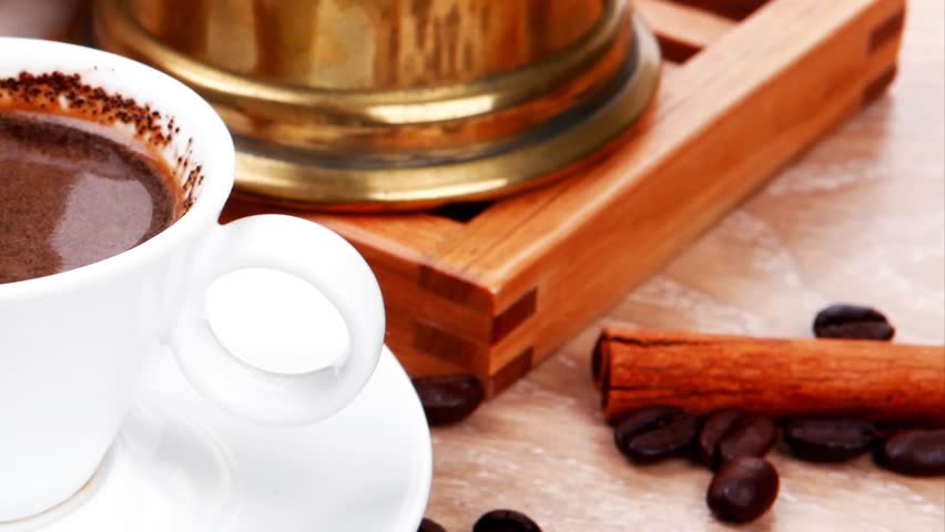 sweet hot drink : black turkish coffee in small white mug with mortar and pestle coffee beans in white bag copper old style cezve full hot coffee  and anise stars 1920x1080 intro motion slow hidef hd